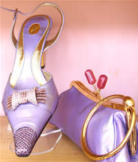 Swarovski Crystal encrusted shoes in pure satin with matching clutch bag